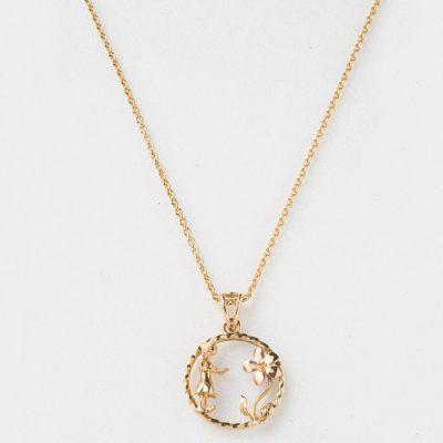 Médaille de baptême « La petite fille à la fleur » Création en or jaune et rose 750/000